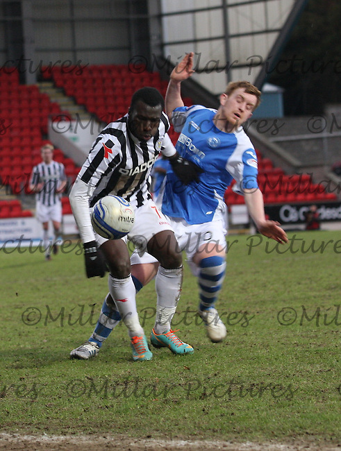 Liam Craig (right) and Esmael Goncalves challenge in the St Johnstone v St Mirren Clydesdale Bank Scottish Premier League match played at McDiarmid Park, Perth on 23.2.13.