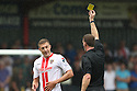 Simon Heslop of Stevenage is shown a yellow card by referee Darren Sheldrake<br />  Stevenage v Oldham Athletic - Sky Bet League 1 - Lamex Stadium, Stevenage - 3rd August, 2013<br />  © Kevin Coleman 2013