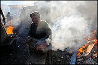 Preparing sheep heads in the fire.
