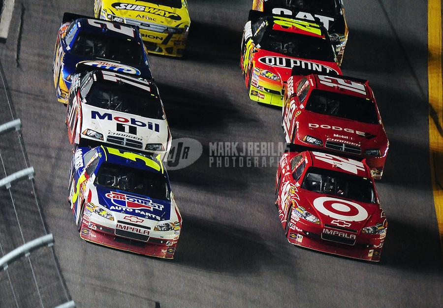 Jul. 3, 2010; Daytona Beach, FL, USA; NASCAR Sprint Cup Series driver Mark Martin (5) races alongside Juan Pablo Montoya (42) for the lead during the Coke Zero 400 at Daytona International Speedway. Mandatory Credit: Mark J. Rebilas-