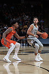 Mitchell Wilbekin (10) of the Wake Forest Demon Deacons is guarded by Ahmed Hill (13) of the Virginia Tech Hokies during first half action at the LJVM Coliseum on January 10, 2018 in Winston-Salem, North Carolina.  The Hokies defeated the Demon Deacons 83-75.  (Brian Westerholt/Sports On Film)