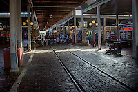 Located in the heart of the Fort Worth Stockyards, Stockyards Station exemplifies Texas by providing an exciting blend of old and new with historic walking tours and over 25 unique shops.<br /> <br /> The Fort Worth Stockyards celebrate Fort Worth's long tradition as a part of the cattle industry and they were listed on the National Register as a historical district in 1976. The Stockyards consist of mainly entertainment and shopping venues that capitalize on the &quot;Cowtown&quot; image of Fort Worth. Home to the famous boot making company M.L. Leddy's which is located in the heart of the Stockyards.  The Fort Worth Stockyards are the last standing stockyards in the United States. Some volunteers still run the cattle drives through the stockyards.