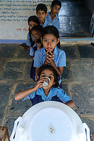 Children line up to drink Safe Water Network iJal water at a school in village Gorikothapally, Telangana, Indiia, on Friday, February 8, 2019. Photographer: Suzanne Lee for Safe Water Network