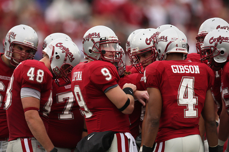 The Washington State University offense, led by quarterback Kevin Lopina (#9) and wide receiver Brandon Gibson (#4), awaits the next play call from the sidelines during a game with the USC Trojans on October 18, 2008, at Martin Stadium in Pullman, Washington.  The Trojans won the game 69-0 to help solidify their spot as one of the top ten teams in the country.
