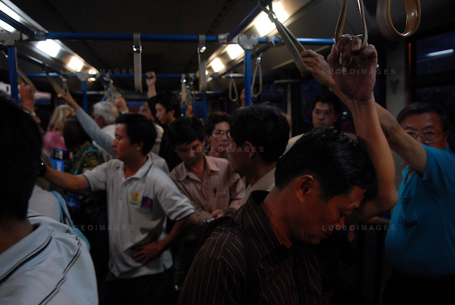 Passengers ride a bus to their plane at the Tan Son Nhat Airport in Ho Chi Minh City, Vietnam.