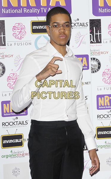 Jahmaal Noel Fyffe ( aka Chip ) (Chipmunk).Reality TV Awards at the Porchester Hall, London, England..August 30th 2012.half length white shirt black trousers glasses hand fingers .CAP/CAN.©Can Nguyen/Capital Pictures.