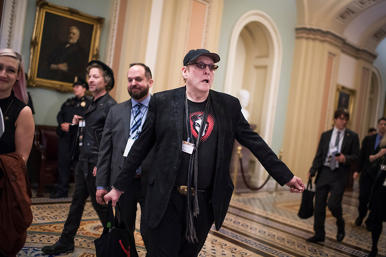 UNITED STATES - APRIL 6: Rick Nielsen of the rock band Cheap Trick makes his way through the Capitol's Ohio Clock Corridor while in town for the Grammys on the Hill event, April 6, 2017. (Photo By Tom Williams/CQ Roll Call)