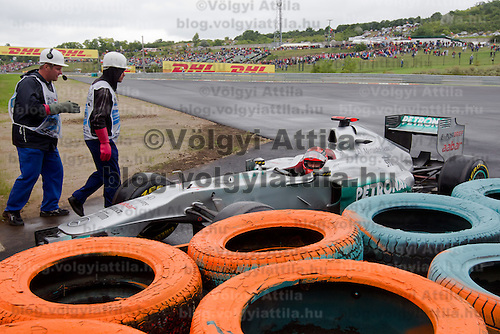 Mercedes Formula One driver Michael Schumacher of Germany is forced to leave the race in a turn during the Hungarian F1 Grand Prix in Mogyorod (about 20km north-east from Budapest), Hungary. Sunday, 31. July 2011. ATTILA VOLGYI