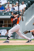 Derrik Gibson (6) of the Norfolk Tides follows through on his swing against the Charlotte Knights at BB&T BallPark on June 7, 2015 in Charlotte, North Carolina.  The Tides defeated the Knights 4-1.  (Brian Westerholt/Four Seam Images)