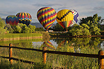 Hot air balloons and reflection in lake, Boulder, Colorado, USA. .  John leads private photo tours in Boulder and throughout Colorado. Year-round.