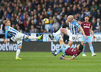 Huddersfield Town's Alex Pritchard and Aaron Mooy challenge West Ham United's Robert Snodgrass<br /> <br /> Photographer Rob Newell/CameraSport<br /> <br /> The Premier League - Huddersfield Town v West Ham United - Saturday 10th November 2018 - John Smith's Stadium - Huddersfield<br /> <br /> World Copyright © 2018 CameraSport. All rights reserved. 43 Linden Ave. Countesthorpe. Leicester. England. LE8 5PG - Tel: +44 (0) 116 277 4147 - admin@camerasport.com - www.camerasport.com
