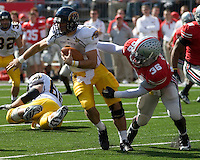 Kent State quarterback Julian Edelman (with ball) tries to avoid the tackle of Ohio State linebacker Brian Rolle (36).  The Ohio State Buckeyes defeated the Kent State Golden Flashes 48-3 on  October 13, 2007 at Ohio Stadium, Columbus, Ohio.