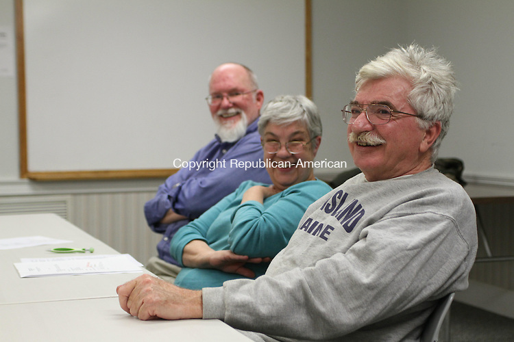 WATERTOWN, CT-25 April 2012-042512LW01- From left, Independent Party members Alan Mickel, Elizabeth Wasiutynski, and Bohdon Wasiutynski attend at party meeting at Thomaston Savings Bank in Watertown Tuesday. Although the party was ousted from office in November, members say they are not backing down.