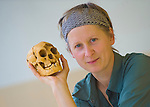 Ines Possemeyer with a skull cast of the Flores hobbit, LB1