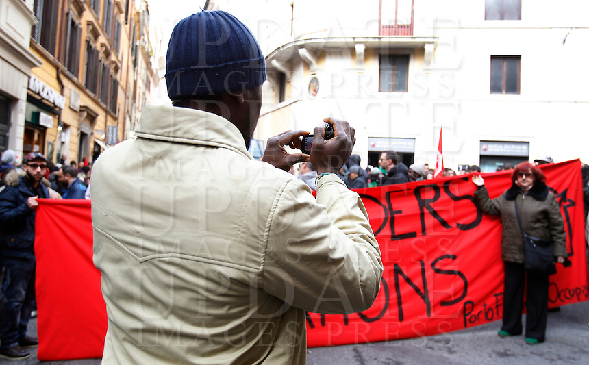 Manifestazione sotto la sede del Partito Democratico, per chiedere la chiusura dei Centri di Identificazione ed Espulsione (CIE) e dei Centri di Accoglienza per Richiedenti Asilo (CARA), a Roma, 27 dicembre 2013.<br /> Demonstrators attend a protest to ask for the closure of migrants Identification and Expulsion Centers (CIE) and Askers for Asylum Welcome Centers (CARA) in front of the Italian center-left Democratic Party's headquarters in Rome, 27 December 2013.<br /> UPDATE IMAGES PRESS/Isabella Bonotto