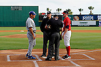 Brevard County Manatees manager Joe Ayrault #67 (right) during the lineup exchange with Dave Keller #28 (left) with umpires Alex Ziegler and John Libka a game against the Daytona Cubs at Spacecoast Stadium on April 5, 2013 in Viera, Florida.  Daytona defeated Brevard County 8-0.  (Mike Janes/Four Seam Images)