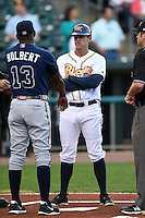 Montgomery Biscuits manager Brady Williams (22) during the lineup exchange with Aaron Holbert (13) before a game against the Mississippi Braves on April 21, 2014 at Riverwalk Stadium in Montgomery, Alabama.  Montgomery defeated Mississippi 6-2.  (Mike Janes/Four Seam Images)