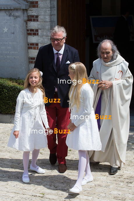Prince Laurent of Belgium and priest Guy Gilbert attend the first communion of twin princes Nicolas and Aymeric of Belgium, at the Sainte-Catherine church, in Bonlez, Belgium.<br /> 29 May 2014.