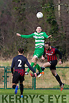 Peter McCarthy Killarney Celtic heads on the cross against Ringmahon Rangers defence during the Munster Junior cup in Celtic Park on Sunday