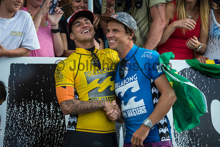 Pipeline, North Shore of Oahu, Hawaii Friday December 19 2014) Gabriel Medina (BRA) 2014 World Surfing Champion with  Julain Wilson (AUS), the new Pipeline Masters. . - The final stop of the 2014  World Championship Tour, the Billabong Pipe Masters in Memory of Andy Irons, was  ccompleted today in NW double overhead surf. <br /> Gabriel Medina (BRA) became the first ever Brazilian World Champion after both rival contenders , Kelly Slater (USA) and Mick Fanning (AUS) were eliminated from the contest. Medina went onto finish 2nd overall behind Julian Wilson (AUS). <br /> In the overlapping heat format Wilson surf three consequent heats and still had enough entry to take out the 30 minute final.<br /> By winning the final Wilson also won the covered Vans Triple Crown of Surfing for best overall performance through the whole Triple Crown.<br /> <br /> The Billabong Pipe Masters in Memory of Andy Irons will determine this year&rsquo;s world surfing champion as well as those who qualify for the elite tour in 2015. As the third and final stop on the Vans Triple Crown of Surfing Series  the event will also determine the winner of the revered three-event leg.<br /> <br />  Photo: joliphotos.com