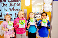 """RACHEL DICKERSON/MCDONALD COUNTY PRESS Southwest City students Lexie Kidd, Hagen Moffett, Gage Huggins and Christian Maza are pictured with copies of """"The BFG,"""" the book chosen for this year's One Book, One County, the countywide read along."""