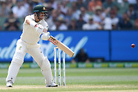 28th December 2019; Melbourne Cricket Ground, Melbourne, Victoria, Australia; International Test Cricket, Australia versus New Zealand, Test 2, Day 3; David Warner of Australia pushes the ball to the offside - Editorial Use