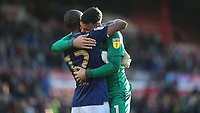 Kamohelo Mokotjo of Brentford hugs goalkeeper David Raya at the final whistle as they celebrate their victory during Brentford vs Millwall, Sky Bet EFL Championship Football at Griffin Park on 19th October 2019