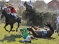 THE JOHN SMITHS FOXHUNTERS CHASE. Jockey James Tudor crashes to the round as SILVERBURN falls at Beechers brook, Aintree Racecourse, Aintree, Merseyside, England. April 4, 2013. Photo by i-Images/DyD Fotografos