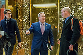 Sean Spicer, center, is seen conversing with representatives of the White House Correspondents' Association in the lobby of Trump Tower in New York, NY, USA on January 5, 2017. <br /> Credit: Albin Lohr-Jones / Pool via CNP