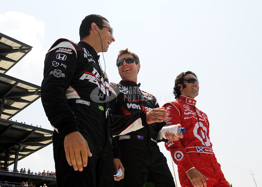 May 30, 2010; Indianapolis, IN, USA; IndyCar Series driver Helio Castroneves (left) and teammate Will Power (center) and Dario Franchitti during the Indianapolis 500 at the Indianapolis Motor Speedway. Mandatory Credit: Mark J. Rebilas-