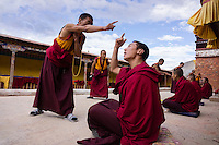 Bon monks debate Buddhist texts at Yong Zhong Lin Monastery in Xigaze, Tibet, China, 2015. The original Bon (Yungdrung Bon) was founded around 16,000 BC,  according to the followers who are called Bonpo. Today, Bon can be found in the more isolated parts of northern and western Tibet. According to the Chinese census, about 10% of Tibetans (about 100,000 people) follow Bon.