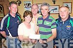 WINNER ALRIGHT: Valerie McGillycuddy from Tiernaboul, Killarney receiving a cheque for EUR6,600 following her lotto win with Milltown-Castlemaine GAA Club members, l-r: Damien McCarthy, Albert King, Willie O'Shea and Willie Hanafin.