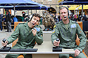 """Cast members, Lewis Howard (as Callum) and  Ben Dyson (as Paddy) from """"Swivelhead"""", Pipeline Theatre's new play, meet a barn owl and an eagle owl in the courtyard at the Pleasance. """"Swivelhead"""" runs from 3rd - 29th August in Pleasance 2."""