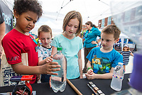 NWA Democrat-Gazette/BEN GOFF @NWABENGOFF<br /> Max Spencer (from left), 9, of Bristol, N.H., and his cousins Hunter Austin, 7, Sadie Austin, 9, and Spencer Austin, 7, of Bentonville learn about science Friday, June 7, 2019, at the NWA Space booth during First Friday on the Bentonville square. This month the theme was 'Living Local' with a focus on local history, food, music and businesses. NWA Space is an organization that is fundraising to build a space science center that will feature a large antique telescope and planetarium, among other features, in Northwest Arkansas.