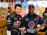Jun 2, 2018; Joliet, IL, USA; Papa Johns Pizza chairman/CEO John Schnatter (left) with NHRA top fuel driver Antron Brown during qualifying for the Route 66 Nationals at Route 66 Raceway. Mandatory Credit: Mark J. Rebilas-USA TODAY Sports