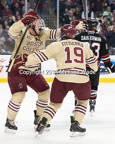 Patrick Brown (BC - 23) and Ryan Fitzgerald (BC - 19) celebrate Brown's goal. - The Boston College Eagles defeated the Northeastern University Huskies 4-1 (EN) on Monday, February 10, 2014, in the 2014 Beanpot Championship game at TD Garden in Boston, Massachusetts.