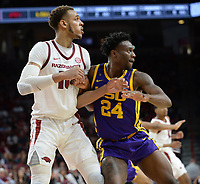 NWA Democrat-Gazette/ANDY SHUPE<br /> Arkansas forward Daniel Gafford (left) and LSU forward Emmitt Williams battle for position Friday, Jan. 11, 2019, during the second half of play in Bud Walton Arena in Fayetteville. Visit nwadg.com/photos to see more photographs from the game.