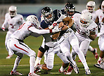 Fresno State defenders Malcolm Washington, Derron Smith and Donavon Lewis tackle Nevada quarterback Cody Fajardo in the first half of an NCAA college football game in Reno, Nev., on Saturday, Nov. 22, 2014. Fresno State won 40-20. (AP Photo/Cathleen Allison)