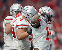 Ohio State Buckeyes running back Ezekiel Elliott (15) celebrates his rushing touchdown with offensive lineman Chase Farris (57) against Notre Dame Fighting Irish in the second quarter during the Fiesta Bowl in the University of Phoenix Stadium on January 1, 2016.  (Dispatch photo by Kyle Robertson)