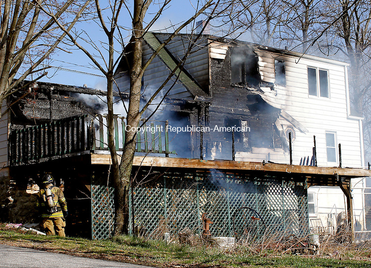 Thomaston, CT-26 March 2012-032612CM06-  The back of the residence on the corner of High Street Ext and Mason Hill where a fire broke out Monday afternoon in Thomaston.   Christopher Massa Republican-American