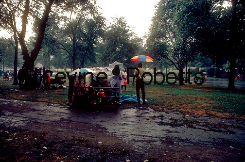 Picnicers in Central Park wait out a late afternoon rainstorm in August 1969. (© Richard B. Levine)