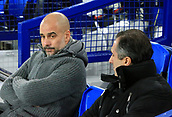 6th February 2019, Goodison Park, Liverpool, England; EPL Premier League Football, Everton versus Manchester City; Manchester City manager Pep Guardiola in the dugout as he chats to assistant Manuel Estiarte prior to the kick off