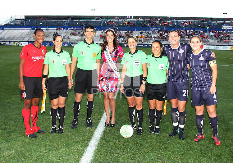 Cat Whitehill #4 and Abby Wambach #20 of the Washington Freedom with Kia McNeill #6 of the Atlanta Beat pose with the game officials and Miss Maryland during a WPS match at Maryland Soccerplex on September 11 2010, in Boyds, Maryland. Freedom won 1-0.