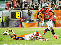 January 3, 2014 - Miami Gardens, Florida, U.S: Ohio State Buckeyes quarterback Braxton Miller (5) avoids a Clemson Tigers defender during the Discover Orange Bowl between the Clemson Tigers and the Ohio State Buckeyes at Sun Life Stadium in Miami Gardens, Fl