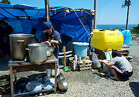 A soup kitchen built on top of a hill at Ishihama where they have no water or electricity and little food just outside Minamisanriku, Myiagi, Japan.The fishing port of Minamisanriku, Miyagi, Japan was devastated by the tsunami where the popultion was reduced from 18,000 to about 8,000 when 10,0000 where washed out to sea.<br /> <br /> Photo by Richard Jones/ Sinopix
