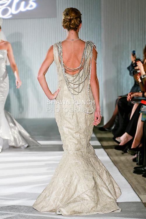 Model walks the runway in a Beth Elis Radiance wedding dress by Nere Emiko during the Wedding Trendspot Spring 2011 Press Fashion, October 17, 2010.