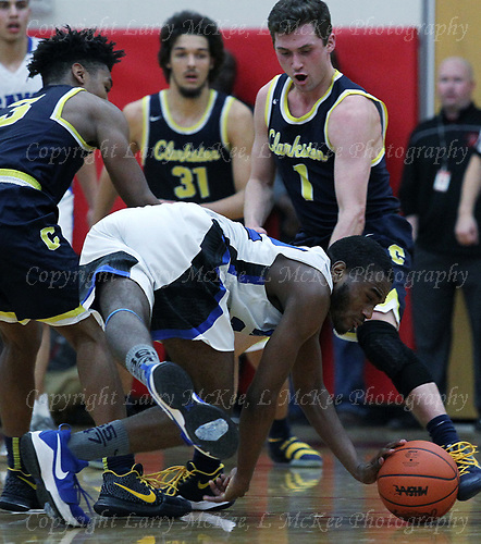 Clarkston defeats Flint Carman-Ainsworth 52-31 in Class A quarterfinal basketball action at Grand Blanc High School Tuesday, March 20, 2018. Photos: Larry McKee, L McKee Photography. PLEASE NOTE: ALL PHOTOS ARE CUSTOM CROPPED. BEFORE PURCHASING AN IMAGE, PLEASE CHOOSE PROPER PRINT FORMAT TO BEST FIT IMAGE DIMENSIONS. L McKee Photography, Clarkston, Michigan. L McKee Photography, Specializing in Action Sports, Senior Portrait and Multi-Media Photography. Other L McKee Photography services include business profile, commercial, event, editorial, newspaper and magazine photography. Oakland Press Photographer. North Oakland Sports Chief Photographer. L McKee Photography, serving Oakland County, Genesee County, Livingston County and Wayne County, Michigan. L McKee Photography, specializing in high school varsity action sports and senior portrait photography.