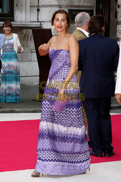 Yasmin Le Bon.Arrivals at the Royal Academy Summer Exhibition 2012 - preview party held at the Royal Academy of Arts, London, England..May 30th, 2012.full length white dress purple maxi dress strapless print clutch bag .CAP/AH.©Adam Houghton/Capital Pictures.