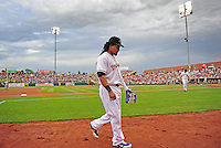 Jun. 23, 2009; Albuquerque, NM, USA; Albuquerque Isotopes outfielder Manny Ramirez heads back to the dugout after the first inning against the Nashville Sounds at Isotopes Stadium. Ramirez is playing in the minor leagues while suspended for violating major league baseballs drug policy. Mandatory Credit: Mark J. Rebilas-