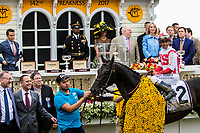 BALTIMORE, MD - MAY 20: Cloud Computing #2, ridden by Javier Castellano, poses for a photo with owner Seth Klarman (far left) and trainer Chad Brown (second from left) after winning the 142nd Preakness Stakes on Preakness Stakes Day at Pimlico Race Course on May 20, 2017 in Baltimore, Maryland. (Photo by Sue Kawczynski/Eclipse Sportswire/Getty Images)